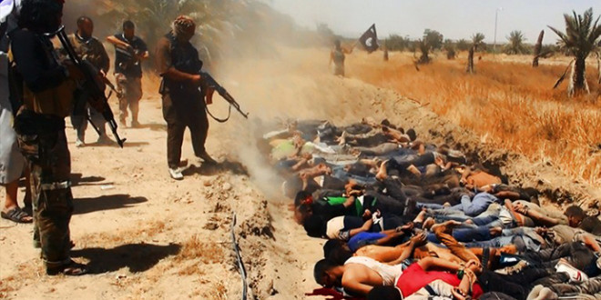 """An image uploaded on June 14, 2014 on the jihadist website Welayat Salahuddin allegedly shows militants of the Islamic State of Iraq and the Levant (ISIL) executing dozens of captured Iraqi security forces members at an unknown location in the Salaheddin province. A major offensive spearheaded by ISIL but also involving supporters of executed dictator Saddam Hussein has overrun all of one province and chunks of three others since it was launched on June 9. AFP PHOTO / HO / WELAYAT SALAHUDDIN === RESTRICTED TO EDITORIAL USE - MANDATORY CREDIT """"AFP PHOTO / HO / WELAYAT SALAHUDDIN"""" - NO MARKETING NO ADVERTISING CAMPAIGNS - DISTRIBUTED AS A SERVICE TO CLIENTS FROM ALTERNATIVE SOURCES, AFP IS NOT RESPONSIBLE FOR ANY DIGITAL ALTERATIONS TO THE PICTURE'S EDITORIAL CONTENT, DATE AND LOCATION WHICH CANNOT BE INDEPENDENTLY VERIFIED ==="""